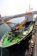 DURBAN - 11 August 2014 - The grab hopper dredger, Italeni at anchor in Durban following her maiden voyage from the Bulgarian shipyards where she was constructed. The vessel is the second of three dredgers that the Dutch shipbuilder IHC Merwede has been contracted to build for South Africa's Transnet National Ports Authority. It is 62 metres long and 15 metres wide with a  gross tonnage of 1000 tons and a dead weight of 1490 tons.  Picture: Allied Picture Press/APP