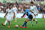 Nacer Chadli of Tottenham Hotspur is blocked by Angel Rangel of Swansea city (l). Barclays premier league match, Swansea city v Tottenham Hotspur at the Liberty Stadium in Swansea, South Wales on Sunday 4th October 2015.<br /> pic by  Andrew Orchard, Andrew Orchard sports photography.