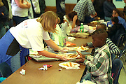 Volunteers serving food Sharing & Caring Hands soup kitchen.  Minneapolis Minnesota USA