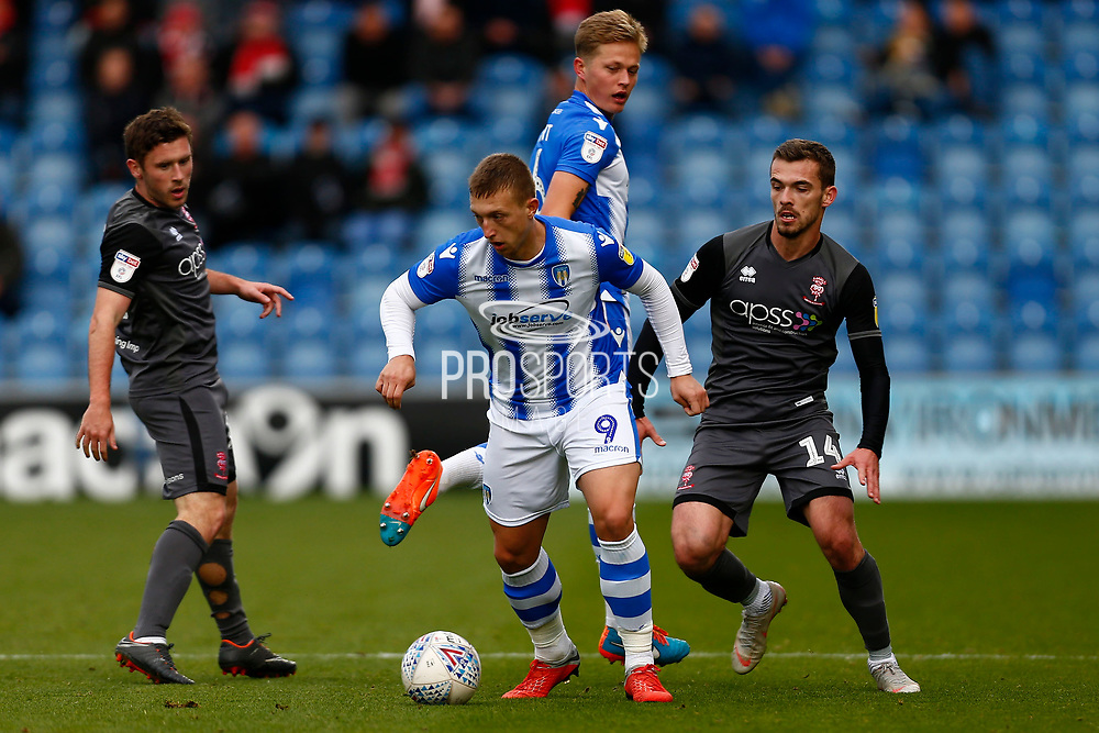 Colchester United forward Luke Norris (9) Lincoln City defender Harry Toffolo (14) battles for possession during the EFL Sky Bet League 2 match between Colchester United and Lincoln City at the JobServe Community Stadium, Colchester, England on 27 October 2018.