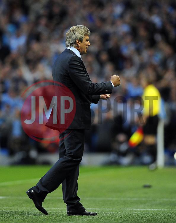 Manchester City Manager, Manuel Pellegrini celebrates Manchester City's second goal  - Photo mandatory by-line: Joe Meredith/JMP - Tel: Mobile: 07966 386802 19/08/2013 - SPORT - FOOTBALL - Etihad Stadium - Manchester - Manchester City V Newcastle United - Barclays Premier League