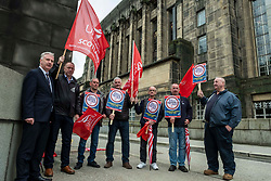 Pictured: <br />Paul Sweeney, Labour and Co-operative MP for Glasgow North East, was joined by MSP James Kelly and engineering workers as he handed in a petition at St Andrews House in Edinburgh today highlighting the final scheduled week of work at the St Rollox railway engineering works in Springburn which demands action to prevent the unnecessary loss of 200 skilled jobs in his constituency.<br /><br />Ger Harley | EEm 23 July 2019