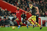 Football - 2019 / 2020 Premier League - Liverpool vs. Southampton<br /> <br /> Liverpool's Mohamed Salah under pressure from Southampton's Jack Stephens<br /> <br /> Colorsport / Terry Donnelly