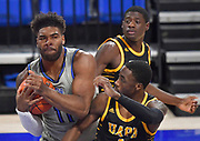 St Louis Billikens forward Hasahn French (11, left) smothers a rebound as Arkansas-Pine Bluff Golden Lions guard Jalen Lynn (1, right) pressures him. In back is Arkansas-Pine Bluff Golden Lions forward Markedric Bell (3). St. Louis University hosted the University of Arkansas - Pine Bluff in a mens basketball game on December 5, 2020 at Chaifetz Arena on the SLU campus in St. Louis, MO.<br />Photo by Tim Vizer