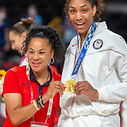 TOKYO, JAPAN August 8:  Head coach Dawn Staley of the United States with A'ja Wilson #9 of the United States with her gold medal during the Japan V USA basket final for women at the Saitama Super Arena during the Tokyo 2020 Summer Olympic Games on August 8, 2021 in Tokyo, Japan. (Photo by Tim Clayton/Corbis via Getty Images)
