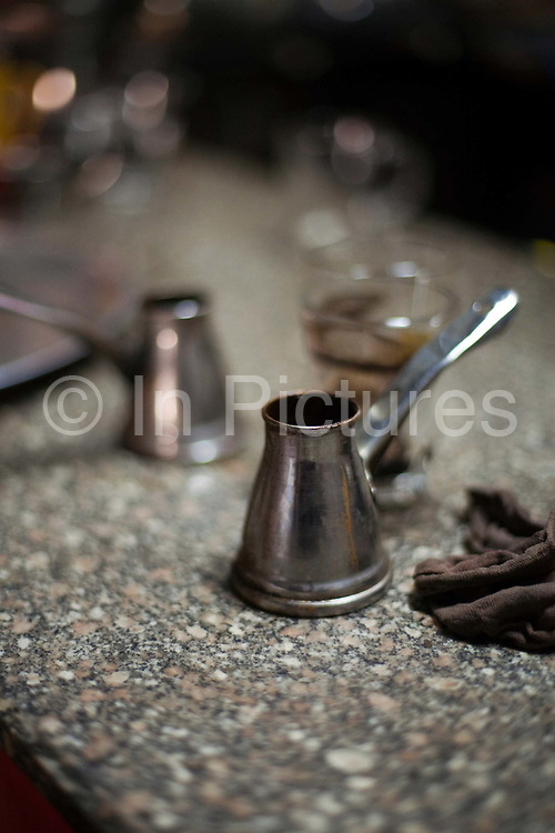 Turkish coffee pot on the counter at the Gold Star cafe, Cairo, Egypt