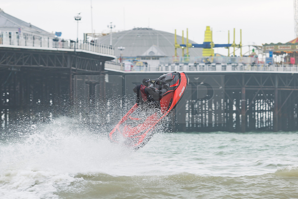 © Licensed to London News Pictures. 19/02/2017. Brighton, UK. A member of the public takes His jet ski out in Brighton as powerful waves are hitting the seaside resort. Photo credit: Hugo Michiels/LNP
