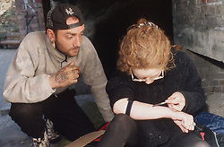 Homeless youths injecting heroin,