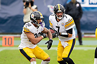NASHVILLE, TN - OCTOBER 25:  Ben Roethlisberger #7 fakes a hand off to James Conner #30 of the Pittsburgh Steelers in the second half of a game against the Tennessee Titans at Nissan Stadium on October 25, 2020 in Nashville, Tennessee.  The Steelers defeated the Titans 27-24.  (Photo by Wesley Hitt/Getty Images) *** Local Caption *** James Conner; Ben Roethlisberger
