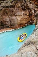 Rowing up Havasu Creek while rafting the Grand Canyon. Grand Canyon National Park, AZ.