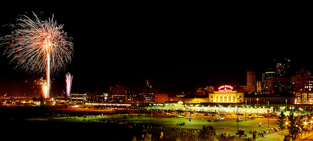 Skyline of Denver with Fireworks from Coors Field and Union Station in the Foreground.