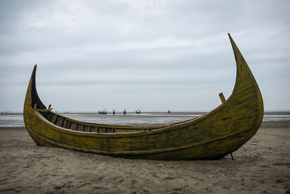Traditional fishing boats on beach near Cox's Bazar, Bangladesh
