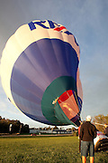 Image of the REMAX balloon being made ready at the Quad Cities Marathon Balloon Festival.