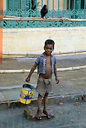 Young boy in the street by Mother Teresa's Mission for the Poor in Calcutta, India