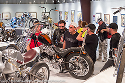 Members of the Harley-Davidson design team check out Harley-Davidson engineer Chris Graves' custom Panhead in the Old Iron - Young Blood exhibition in the Motorcycles as Art gallery at the Buffalo Chip during the annual Sturgis Black Hills Motorcycle Rally. Sturgis, SD. USA. Tuesday August 8, 2017. Photography ©2017 Michael Lichter.