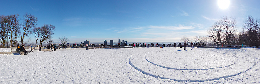 January 09, 2021 - Montreal, Canada Panorama of Mont Royal viewpoint covered in snow on a winter afternoon and clear sky