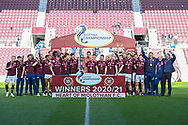 Hearts lift the Championship trophy after the final whistle of the SPFL Championship match between Heart of Midlothian and Inverness CT at Tynecastle Park, Edinburgh Scotland on 24 April 2021.