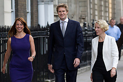© Licensed to London News Pictures. 07/10/2013. London, UK. , Gloria de Piero, shadow minister for women and equalities (L),  Tristram Hunt, shadow education secretary and Emma Reynolds (R), shadow housing minister, the newest members of Ed Miliband's shadow government, are seen on Whitehall in London today (07/10/2013) the Labour leader carried out a shuffle of his cabinet team. Photo credit: Matt Cetti-Roberts/LNP
