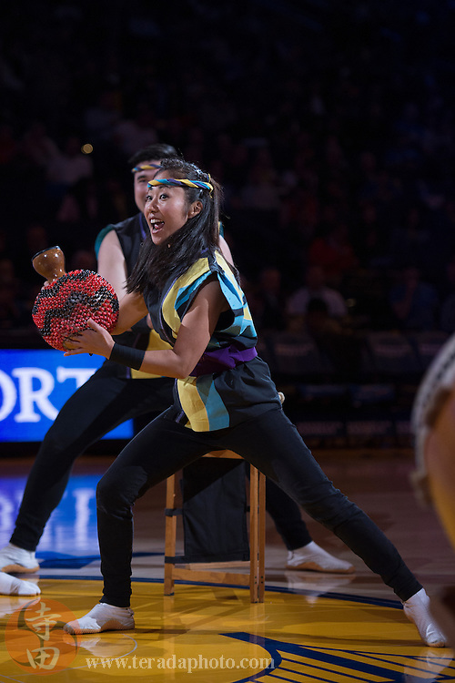 November 17, 2015; Oakland, CA, USA; San Jose Taiko drummer Yurika Chiba performs during halftime of a NBA basketball game between the Golden State Warriors and the Toronto Raptors at Oracle Arena. The Warriors defeated the Raptors 115-110.