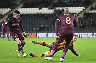 Hull City forward Jarrod Bowen (20) is brought down by Swansea City players during the EFL Sky Bet Championship match between Hull City and Swansea City at the KCOM Stadium, Kingston upon Hull, England on 22 December 2018.