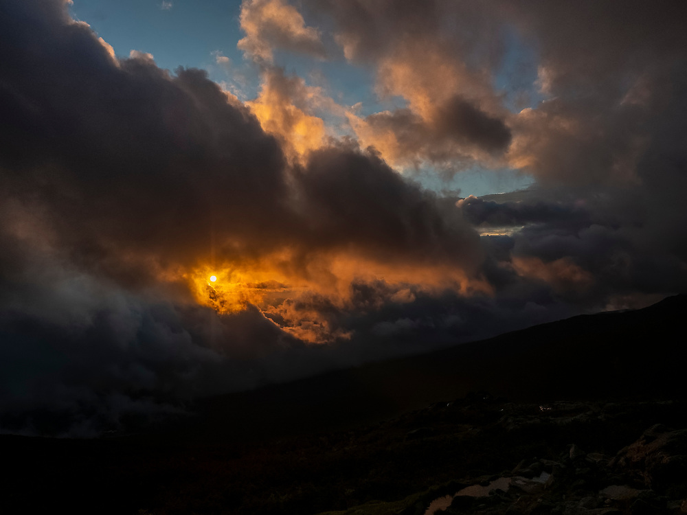 OLYMPUS DIGITAL CAMERA, sun peaking through clouds after a storm on Mt. Washington