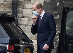 © Licensed to London News Pictures. 23/03/2021. Windsor, UK. Prince William, Duke of Cambridge adjusts his face mask he leaves Westminster Abbey after visiting the vaccine centre. Photo credit: Peter Macdiarmid/LNP