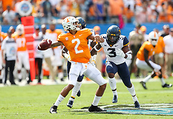 Sep 1, 2018; Charlotte, NC, USA; Tennessee Volunteers quarterback Jarrett Guarantano (2) passes the ball before being hit by West Virginia Mountaineers safety Toyous Avery (3) during the first quarter at Bank of America Stadium. Mandatory Credit: Ben Queen-USA TODAY Sports