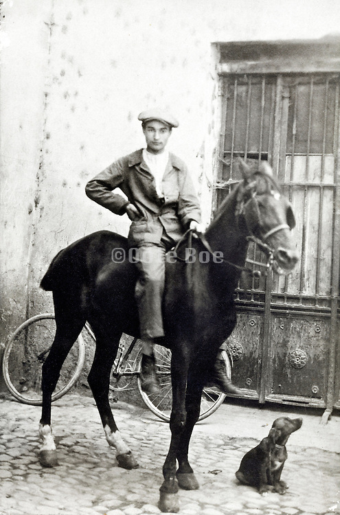 young adult farmer sitting on his horse with a puppy hunting dog 1900s France