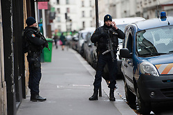 © London News Pictures. 14/11/2015. . Police guard a residential apartment belonging to French Prime Minister Manuel Valls on rue Keller the day after multiple terror attacks on the french capital. Photo credit: Guilhem Baker/LNP