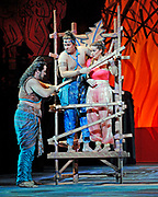 GASTON DE CARDENAS/EL NUEVO HERALD -- Eternal Triangle: Two guys, Zurga played by Lucas Meachemr, left and Nadir played by William Burden, both love the same girl, Léïla played Maureen OÕFlynn, in the Florida Grand Opera production of 'The Pearl Fishers'.