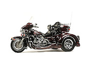 Harley Davidson trike motorcycle in studio on white background