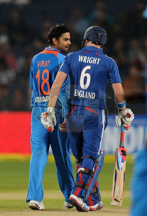Virat Kohli of India exchanges few words with Luke Wright of England during the first Airtel T20 Match between India and England held at Subrata Roy Sahara stadium in Pune on the  20th December 2012..Photo by  Pal Pillai/BCCI/SPORTZPICS .