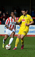 Anthony O,Connor on the ball during the Sky Bet League 2 match between Cheltenham Town and Plymouth Argyle at Whaddon Road, Cheltenham, England on 28 March 2015. Photo by Alan Franklin.