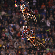 Ryan Dungey, (top), KTM,  in action during the final of the 450SX Class Championship during round 16 of the Monster Energy AMA Supercross series held at MetLife Stadium. 62,217 fans attended the event held for the first time at MetLife Stadium, New Jersey, USA. 26th April 2014. Photo Tim Clayton