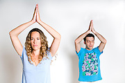young Couple Meditating on white background Model releases available