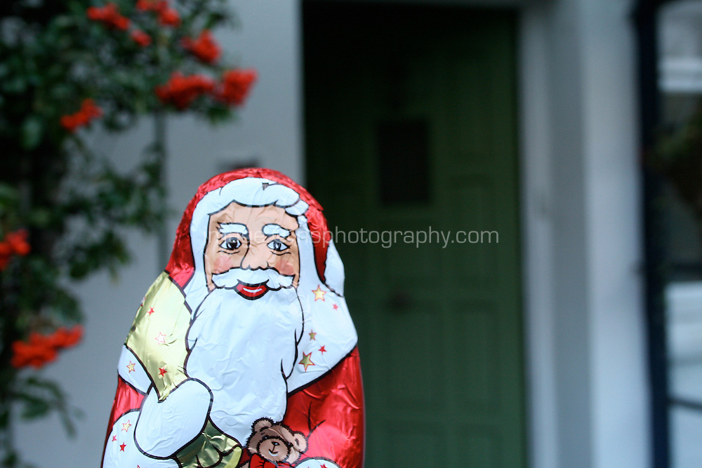Chocolate Santa visiting a house
