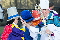 © Licensed to London News Pictures. 28/03/2018. Liverpool, UK. Children dressed as Diddy Men line up outside Liverpool Cathedral after the service and high five a clergyman . The funeral of comedian and performer Sir Ken Dodd , who died on 11th March 2018 at the age of 90 . Photo credit: Joel Goodman/LNP