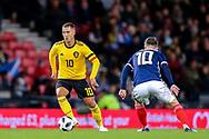 Eden Hazard (#10) of Belgium looks to take on Callum McGregor (#10) of Scotland during the International Friendly match between Scotland and Belgium at Hampden Park, Glasgow, United Kingdom on 7 September 2018.