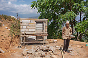 A new latrine under construction beside a house, currently being rebuilt after being destroyed in the 2015 earthquake, Kakani, Nuwakot District, Nepal
