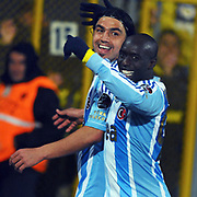 Fenerbahce's Mehmet Topuz (L) celebrate his goal with team mate during their Turkish Superleague soccer match Ankaragucu between Fenerbahce at the 19 Mayis stadium in Ankara Turkey on Sunday 08 January 2012. Photo by TURKPIX