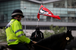 "© Licensed to London News Pictures . 22/08/2015 . Manchester , UK . An anti-fascist counter demonstrator . Far-right nationalist group , "" North West Infidels "" and Islamophobic , anti-Semitic and white supremacist supporters , hold a rally in Manchester City Centre . Photo credit : Joel Goodman/LNP"