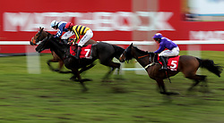 Pete The Feat ridden by Jonathan Burke wins the Matchbook Racing Is Commission Free Handicap Chase during Matchbook Imperial Cup Day at Sandown Park Racecourse, Esher.
