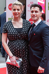 London, UK. 13th March, 2019. Gemma Atkinson and Gorka Marquez arrive at the London Palladium to attend the annual Prince's Trust Awards to be presented by HRH the Prince of Wales, President of the Prince's Trust. The Prince's Trust and TKMaxx & Homesense Awards recognise young people who have succeeded against the odds, improved their chances in life and had a positive impact on their local community.