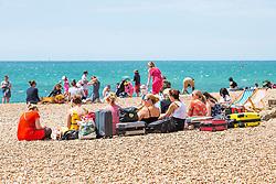 © Licensed to London News Pictures. 30/06/2019. Brighton, UK. Members of the public take to the beach in Brighton and Hove on one of the hottest days of the year so far. Photo credit: Hugo Michiels/LNP