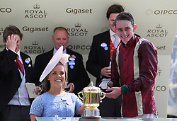 Ellie Simmonds presents a trophy to winning jockey Adam Kirby after the Queen Mary Stakes during day two of Royal Ascot at Ascot Racecourse.