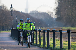 © Licensed to London News Pictures. 22/01/2021. London, UK. Police on bikes patrol around Hyde Park, central London on a cold winter morning. Members of the public have been urged to stay at home as much as possible, in an attempt to slow the spread of COVID-19.  Photo credit: Ben Cawthra/LNP