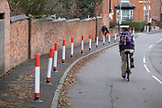 Bollards to protect pedestrians as part of the Low-traffic neighbourhood initiative put in place in Kings Heath on 16th November 2020 in Birmingham, United Kingdom. These traffic restrictions, many of which have been rushed through by local councils during the Coronavirus pandemic have created controversy in local communities, many of whom object the road closures which affect some businesses and roads adversely. The green measures, which have been named 'places for people' by Birmingham City Council are designed reduce traffic and to promote walking and cycling have been criticised for being environmentally unsound, and forcing traffic onto previously quiet roads.