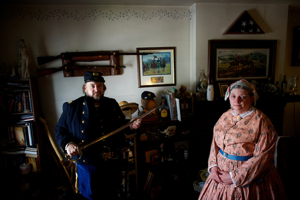Clutching a cavalry saber, Ed Zamorsky, Union Army Lt. Colonel, and Chief Engineer of the GAC 150th reenactment, poses with his sister-in-law Julia Ann Sedlock, Camp Seamstress and 2nd Assistant Cook, in Zamorsky's Pottstown, PA residence on June 28, 2013.