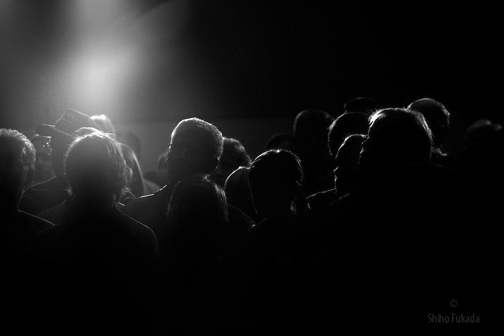 People listen to U.S. Democratic Presidential candidate John Edwards  speak at Drake University in Des Moines, Iowa.