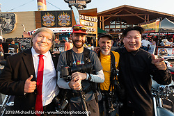 Michael and Sean with Trump and Kim Jong-un on Main Street for the 78th annual Sturgis Motorcycle Rally. Sturgis, SD. USA. Saturday August 4, 2018. Photography ©2018 Michael Lichter.